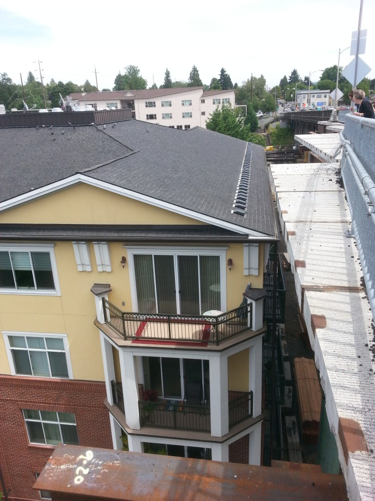 It's been difficult to wedge a project this big into a quiet neighborhood like Sellwood, but the crews have done an amazing job.  This picture of the bridge and the condominiums on the north side shows just how careful they're being.