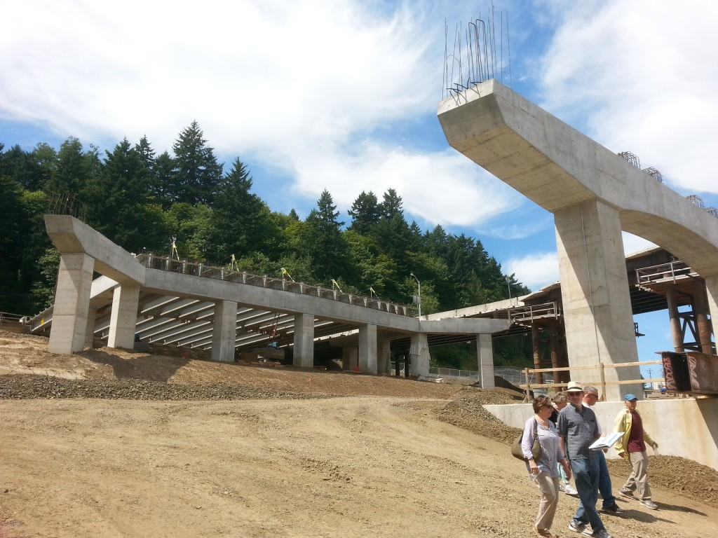 The new interchange on the west side of the river is a major part of the Sellwood Bridge project.  This picture shows the west approach span to the bridge in the foreground, with the interchange itself in the background.