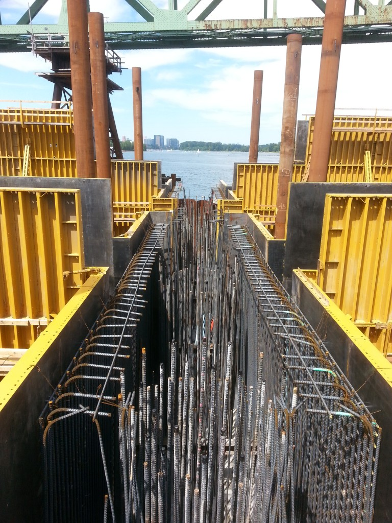 The steel arches will touch down on concrete supports at two points in the water.  This is a view into the box where the concrete bases will be cast, showing the massive amounts of rebar needed to make the concrete structurally sound.