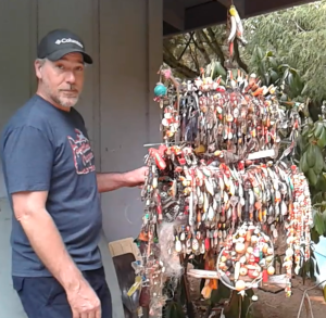 James Magmer displays his trashfishing collection
